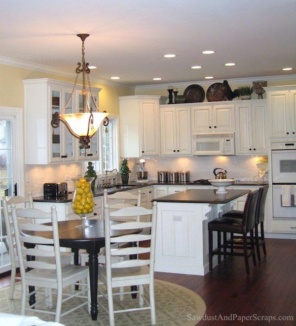 kitchen with white cabinets and black granite countertops