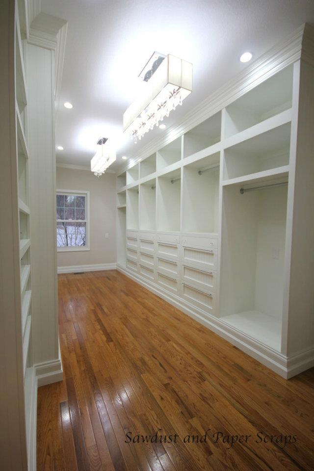 white painted cabinets in built-in closet