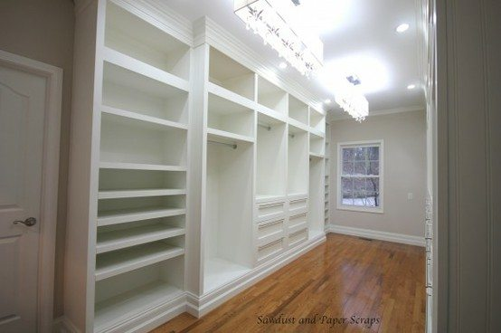 white built-in master closet design