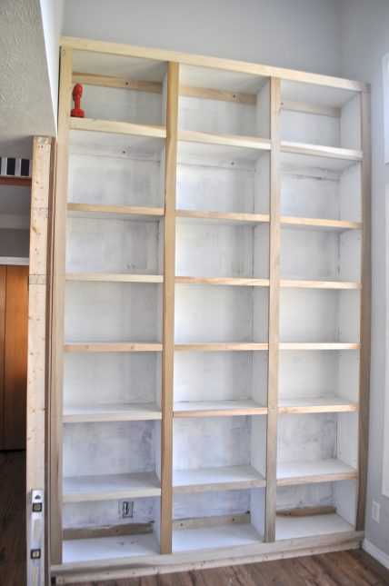 Built in bookcases in library. Wall to wall and super tall