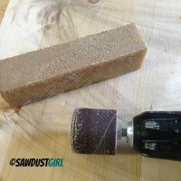 Abrasive cleaning stick extends life of sandpaper