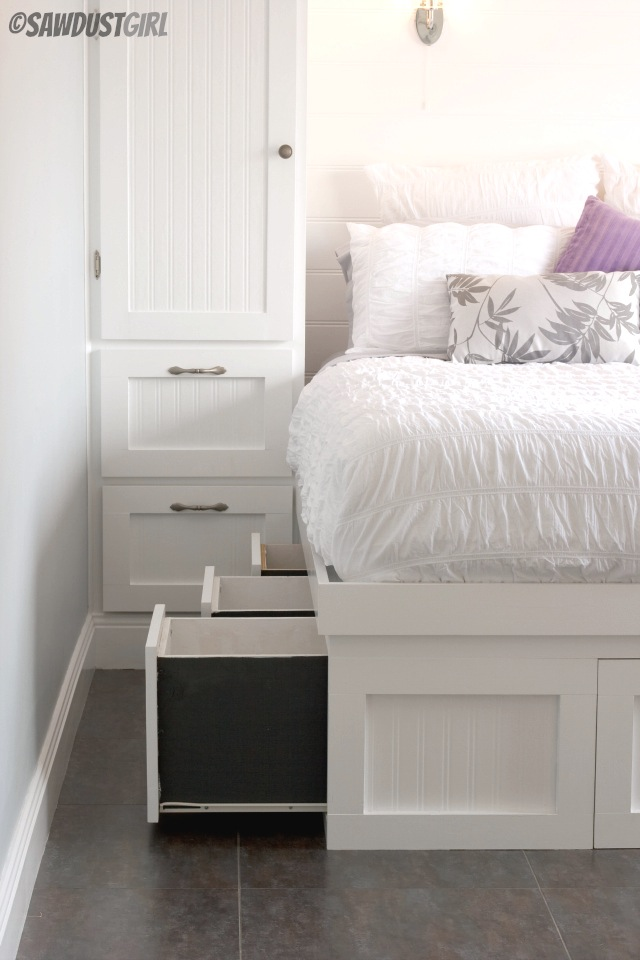 Small bedroom storage solution: Built-in storage bed and built-in wardrobes. https://sawdustgirl.com