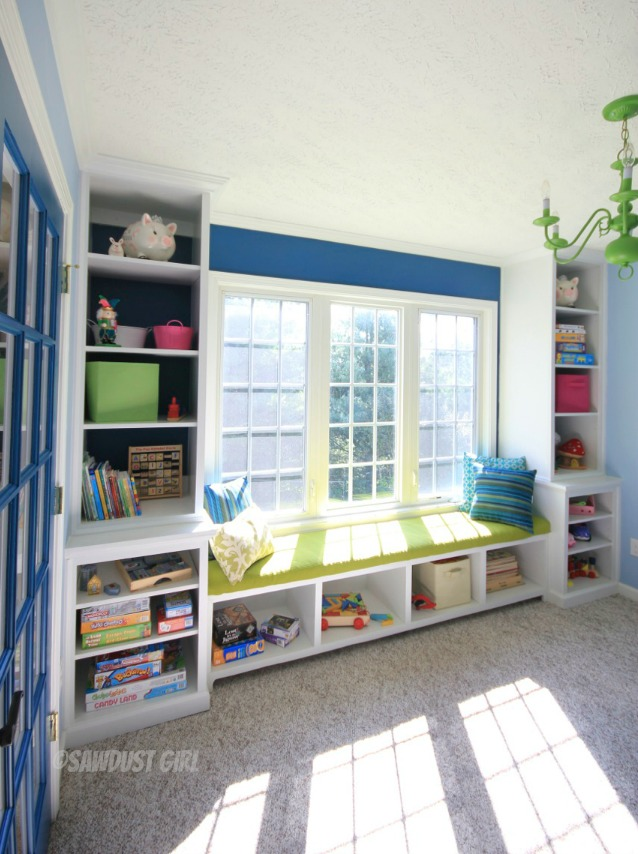Playroom built-in window seat and storage.   http://sawdustdiaries.com