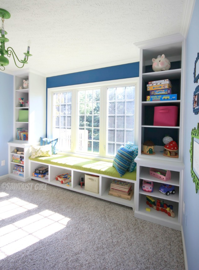 Playroom window seat and built-in storage.  http://sawdustgirl.com