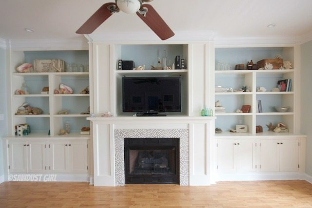 Built-in bookshelves and fireplace surround. https://sawdustgirl.com