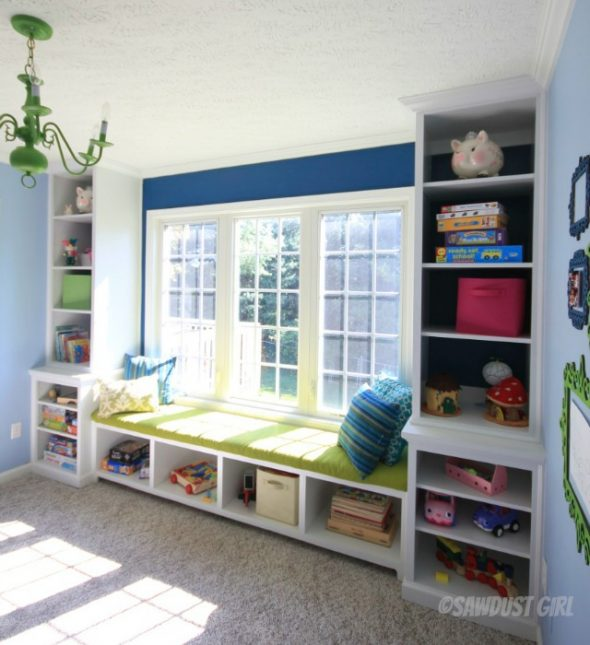 Playroom built-in window seat and bookshelf storage. https://sawdustdiaries.com