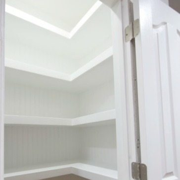 Hall Closet with Floating Shelves
