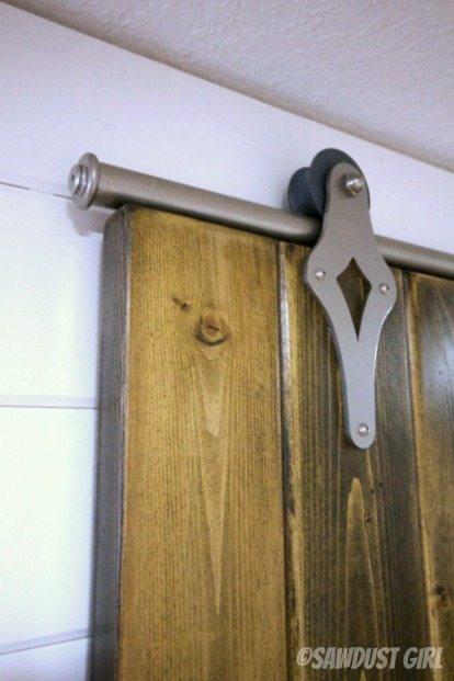 Barn door installation sawdust girl
