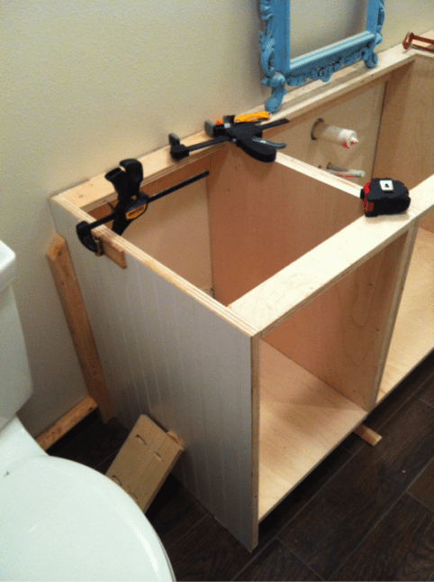 installing DIY cabinets in bathroom