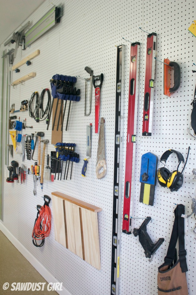 Pegboard wall for tool storage and workshop organization.