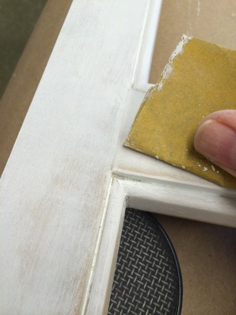 6 prime and paint - fold a piece of sand paper to get into the bead and clean it up