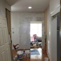 Fixing wonky walls with joint compound and skim coating.