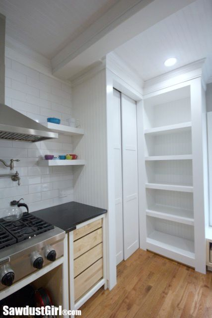 DIY sliding pocket doors for hidden pantry.