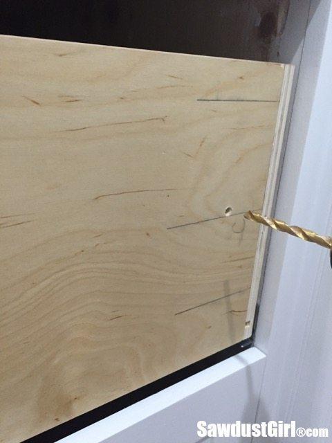 Drill holes for drawer front adjusting screws