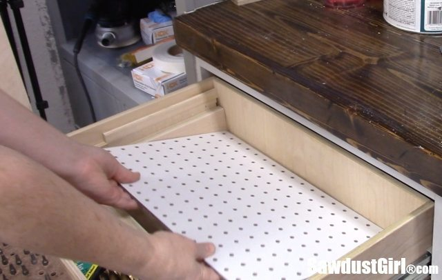 Make a DIY Drawer Organizer with pegboard.