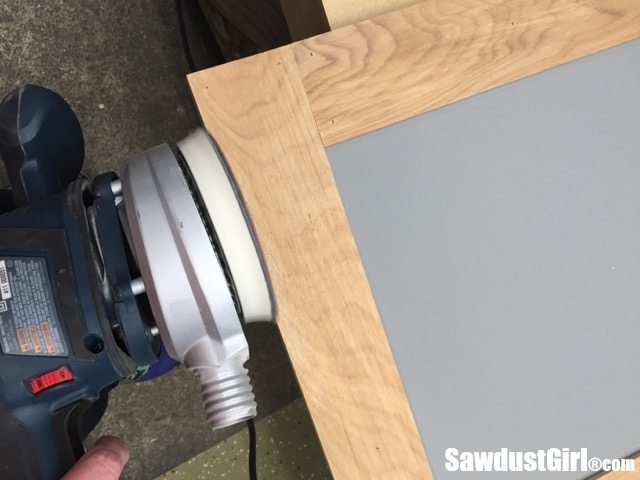 sanding edges of sliding cabinet doors