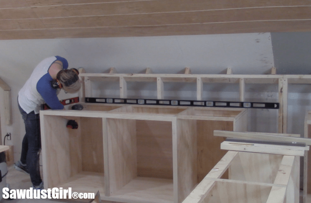 Installing Craft Room cabinets