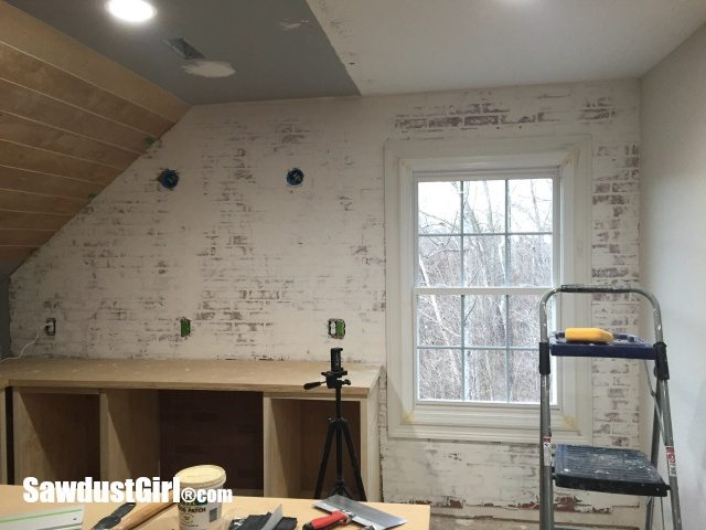 Plaster Wall With Faux Brick Panels