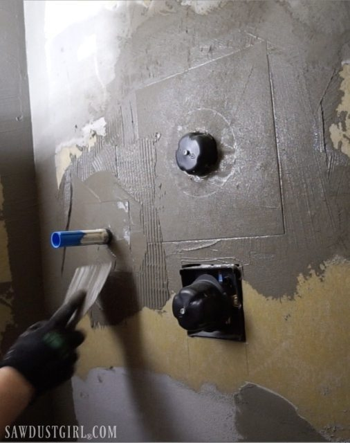 Installing waterproof panel shower walls.