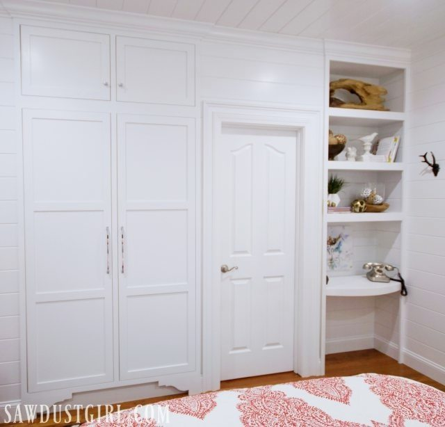 Built-in tiny closet in small bedroom.