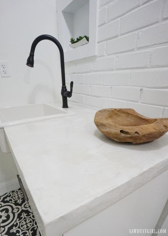 concrete countertops, farmhouse sink, white and black