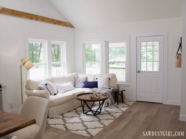 natural living room decor, exposed wood beam