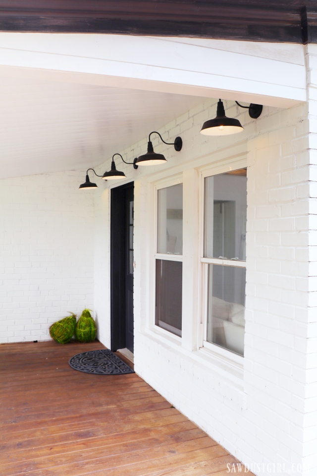 front porch, white brick, black accents, barn lights