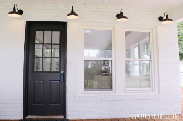 front porch with black door