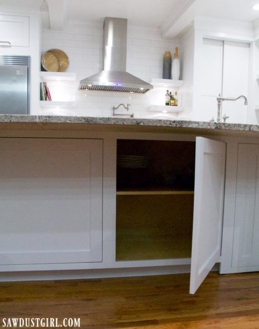 Hidden cabinet under kitchen island