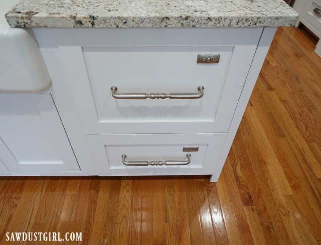 Custom panel, built-in dishwasher drawers.