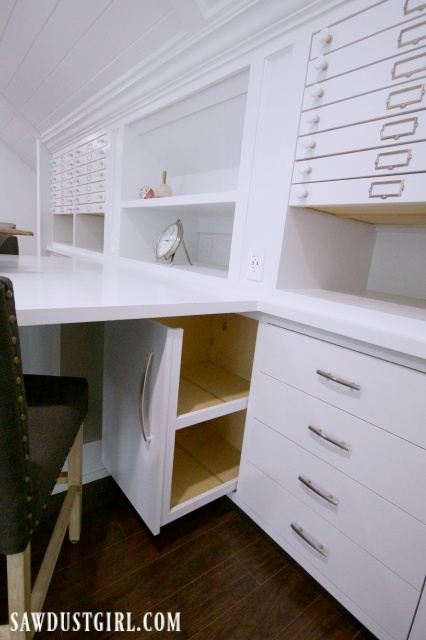 Pull out cabinet storage in craft room