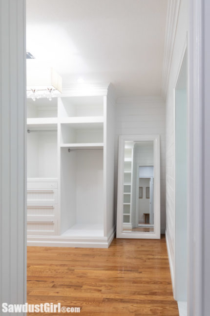 Large walk-in closet with custom cabinetry