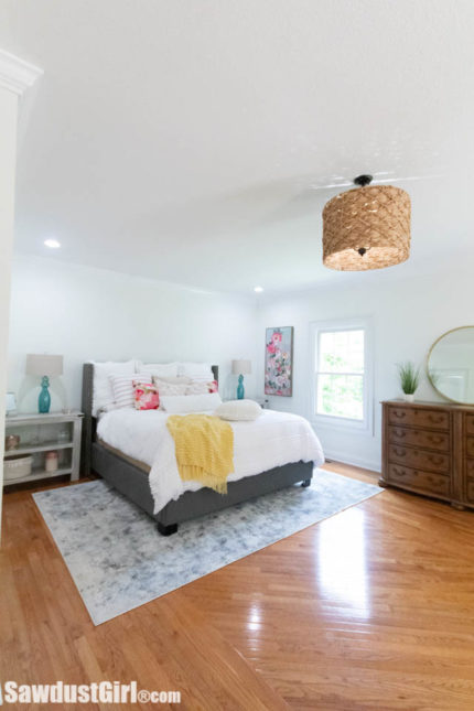 master bedroom with custom wicker light