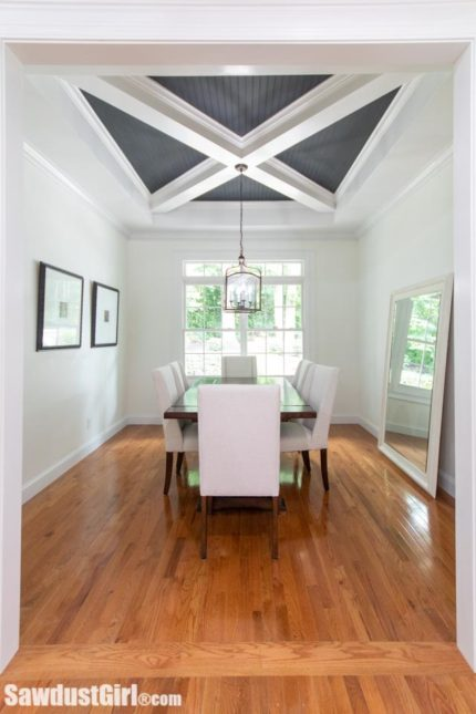 Beautiful dining room with unique ceiling treatment